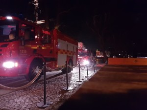 The fire department has arrived at the hostel