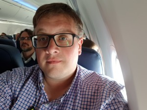 Me on plane with new glasses :)